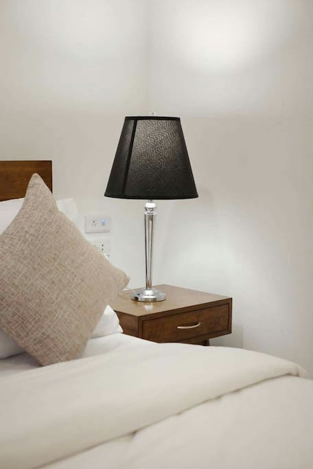 Comfortable beds, linens and nightstand because a good night's sleep is extremely important!