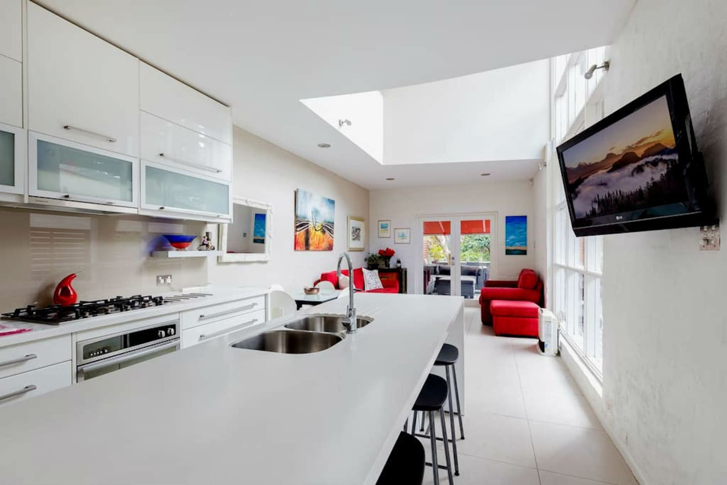 Bright and airy fully equipped kitchen with floating kitchen island.