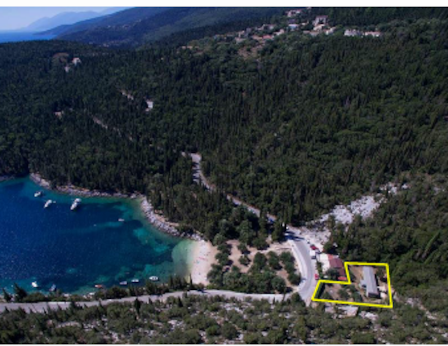 AN AERIAL PHOTO OF FOKI BAY - FOKI BEACH HOUSE IS MARKED WITH YELLOW LINE