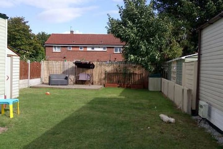 Spacious family owned caravan with large garden