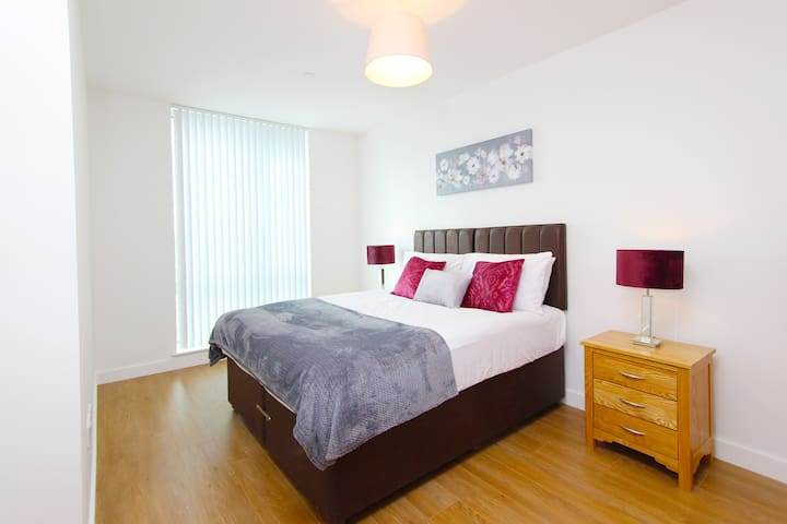 A Bedroom. Please note that we have multiple apartments in this development which may differ in decoration and shape. We do however provide same level of quality and functionality across apartments.  On request we will endeavour to provide additional information about the specific apartment you will stay in.
