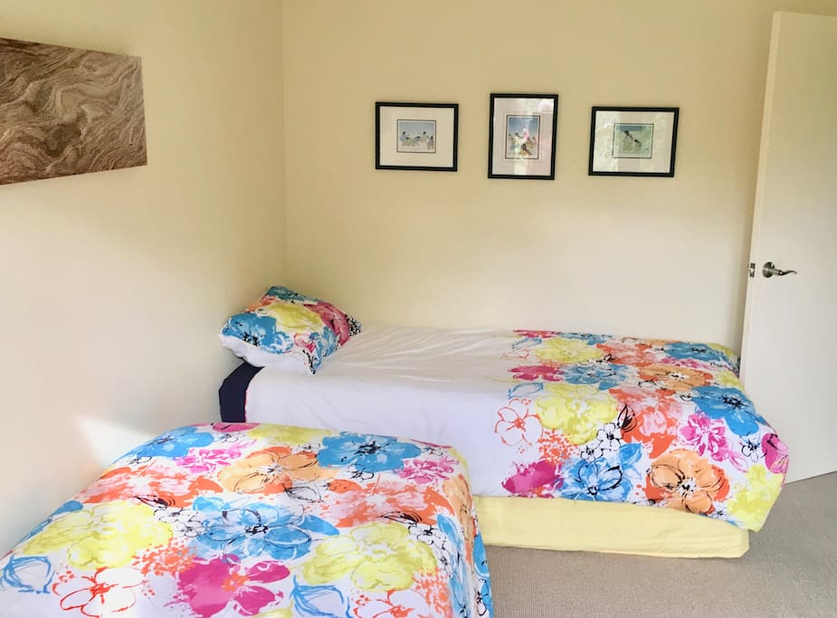 2 single beds and a Single Trundle bed tucked under