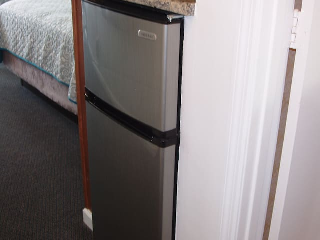 mini fridge with freezer. Ice trays in freezer and ice machines are available.