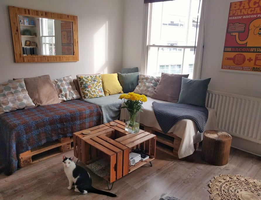 Downstairs: Our open space living room with DIY pallet sofa and crates coffee table