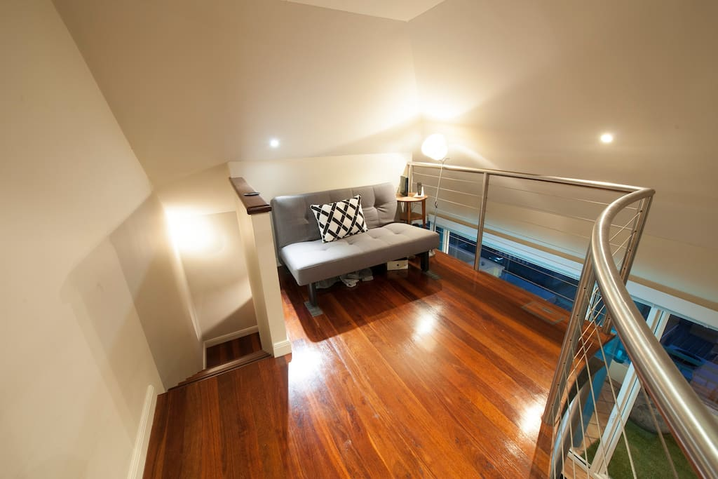 Mezzanine area, retreat or reading area with a comfortable fold out (queen size) couch that can be used as a bed. Add 2 people if required