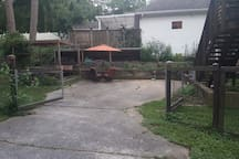 Off-street parking.  Located inside of fenced back-yard and steps to your private entrance. Note that the table is no longer there.