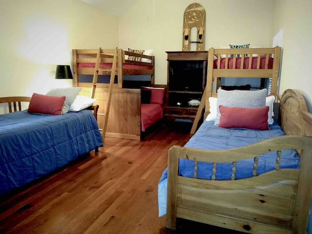 We call it the bunk room for obvious reasons. The kids will have a blast in here. This room will sleep 10 rug-rats. Can you imagine the stories the little ones will share in here? Nothing better than staying in one room with all your buddies.