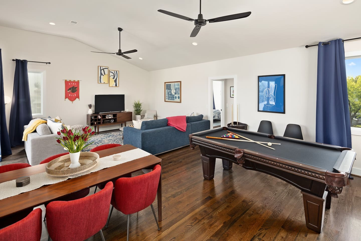 The third floor is a my favorite place in the house. Enjoy the pool table, living room, dining area, wet bar, and roof top deck access all from this floor. A 3rd floor bedroom with 2 queen beds and a full bath are set towards the back of the space.