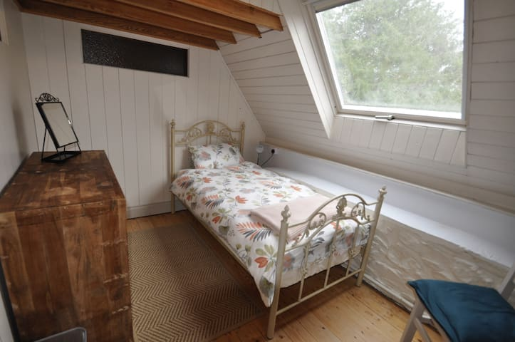 Beautiful , bright single bedroom with large  chest of draws and a blackout blind
