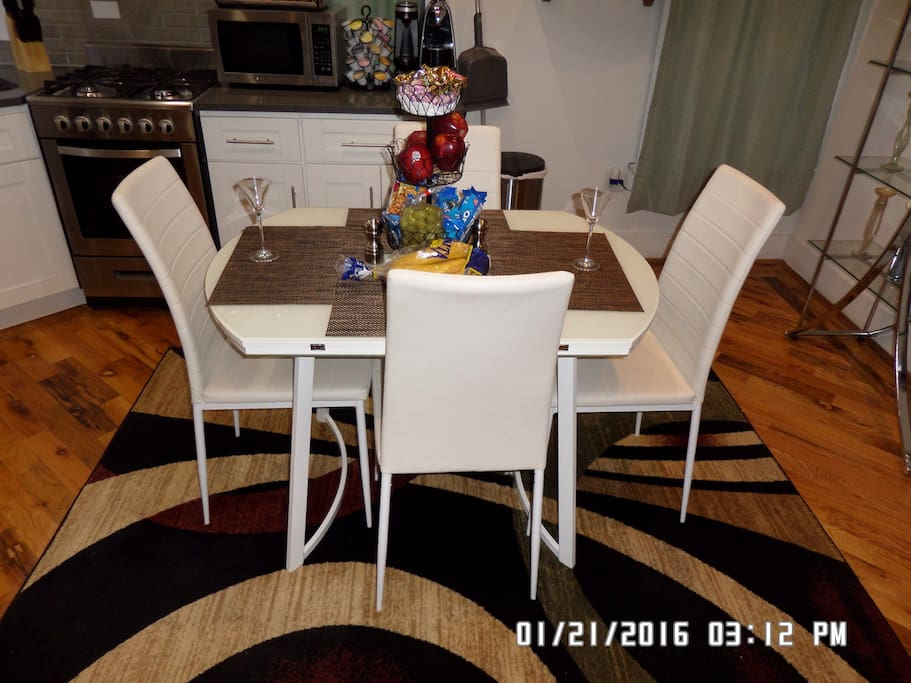 Modern dining table, can open with two extensions, free  Fruits, soft drinks, coffee and tea.
