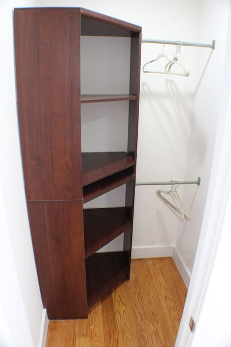 Walk in closet with built in shelves. We provide extra amenities like that umbrella for our guests : )