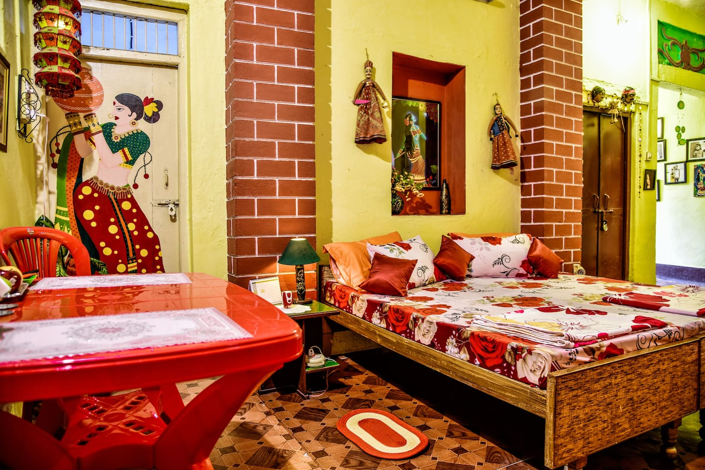Airbnb Guest Room with comfortable double bed, dining/ laptop table and colorful interiors