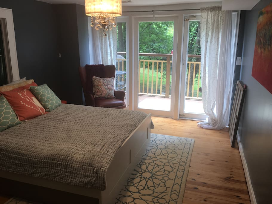 Lovely bedroom with tons of natural daylight and private deck.  The full bathroom is attached to the bedroom.