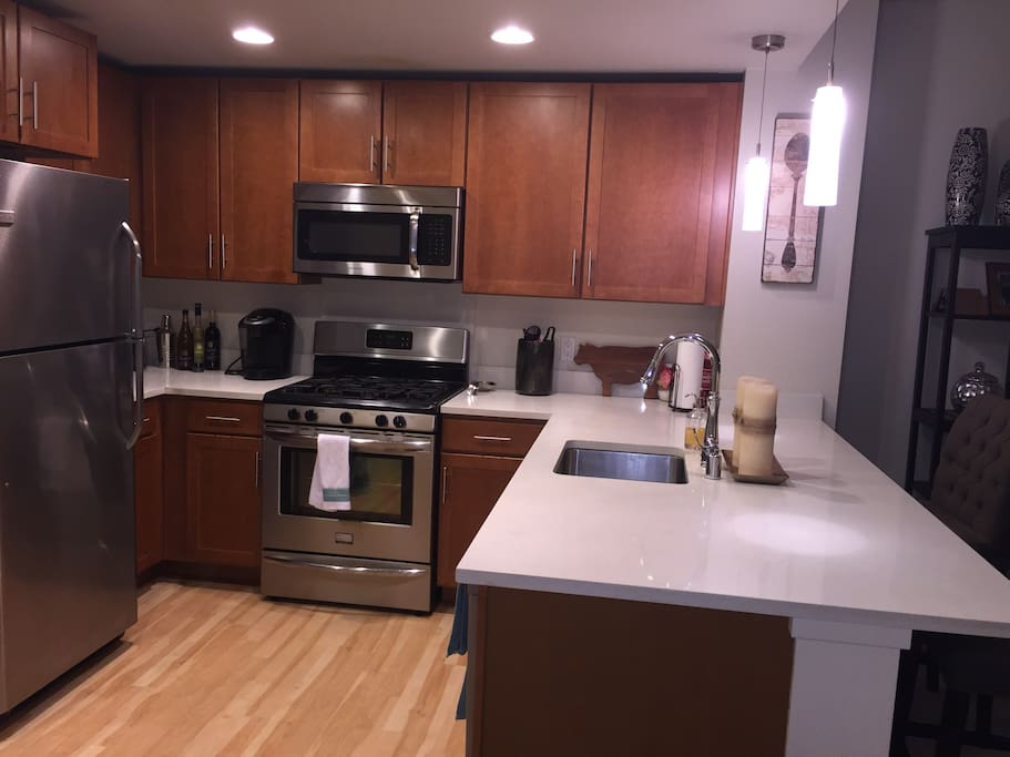 Top End Appliances, large counter with seating.