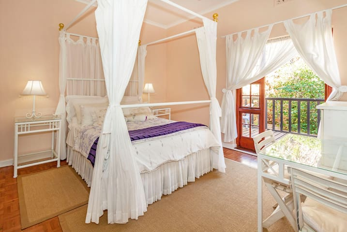 Guest Bedroom with an outdoor terrace that leads to the swimming pool. With en-suite bathroom with a bath, shower, toilet and basin.