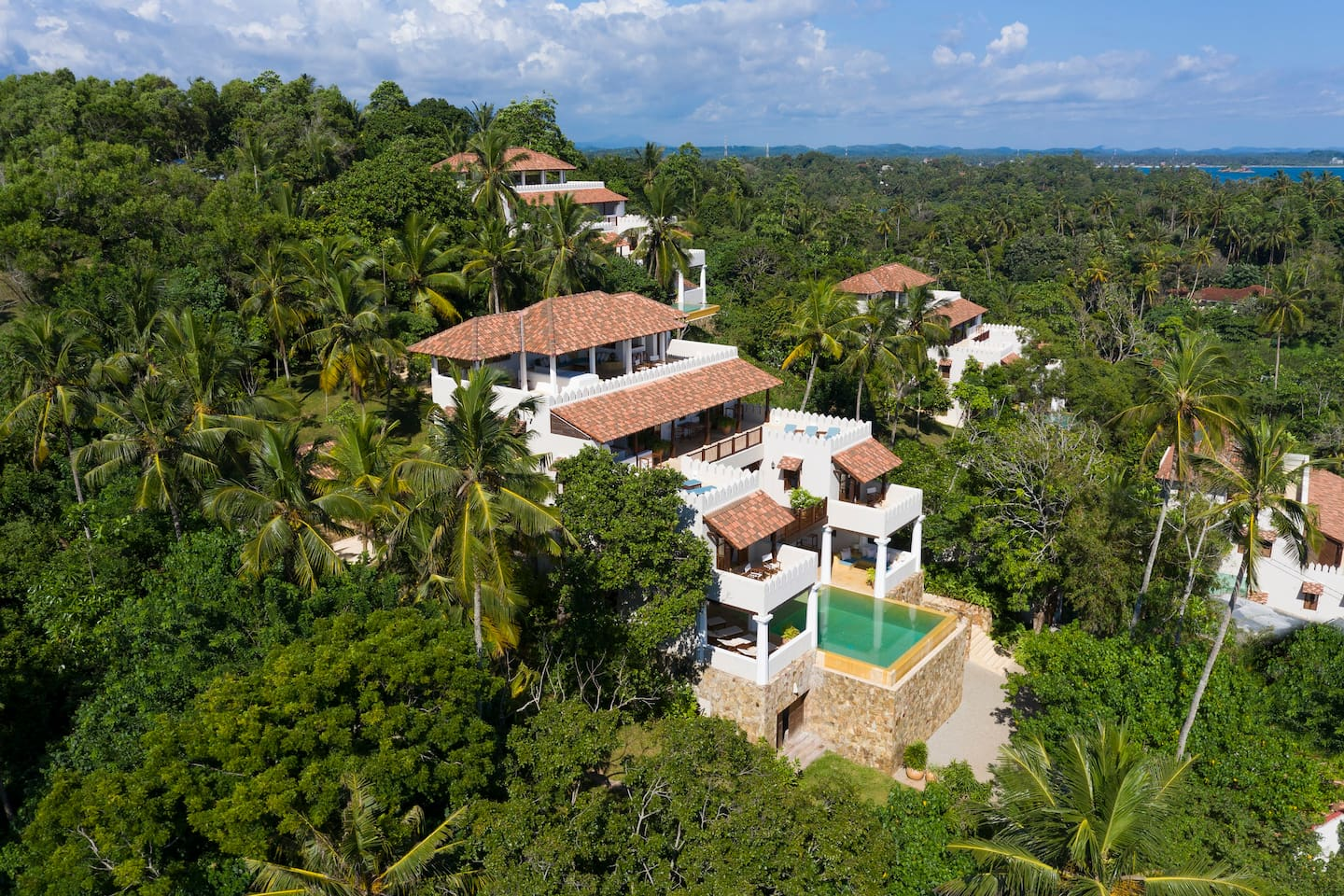 ON Houses - nestled in their tropical gardens