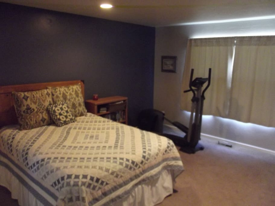 15 x 14 Bedroom  with queen bed and television set