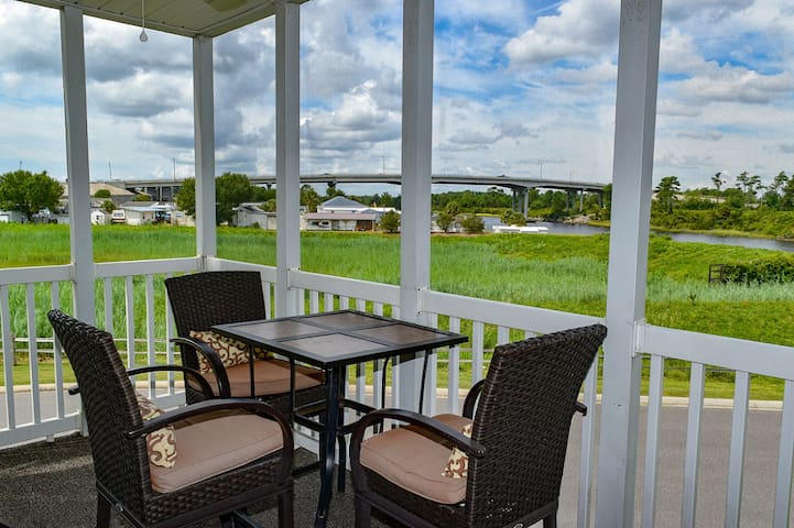 Intracoastal Waterway One mile from the beach 2 bedroom 2 bath condo on the 2nd floor No elevator Sleeps 6 Outdoor pool Jacuzzi non smoking no pets no motorcycles Gated community Families only No student groups