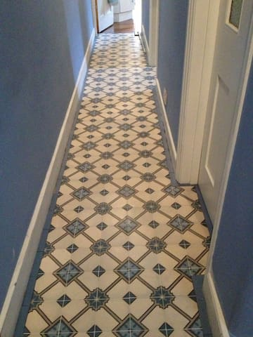 Hallway with antique tiles.
