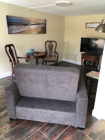 Living Room with tv stero/radio.Chair reclines or pulls out to twin bed