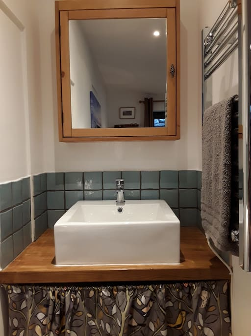 Beautiful Belfast sink with mirror cabinet.