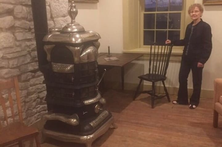Parlor room with my favorite guest..The parlor stove has a LED light to mimic a fire