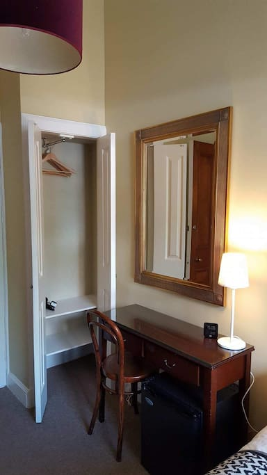 Room 5: Your room has a small wardrobe, table and chair