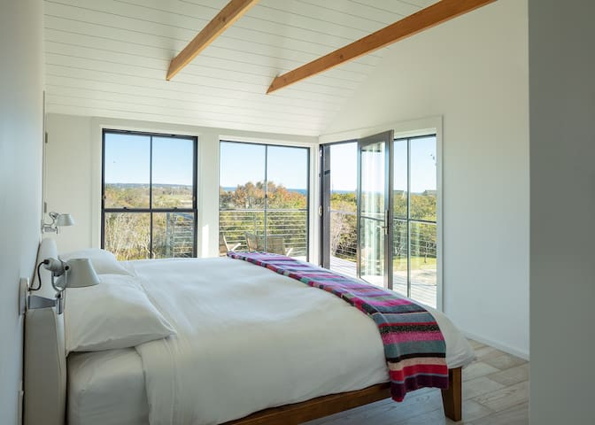 The master suite has a king size bed, an ensuite with a rain shower and curbless entry, and a wrap around balcony with 180 degree views of the Atlantic Ocean and Long Island Sound.