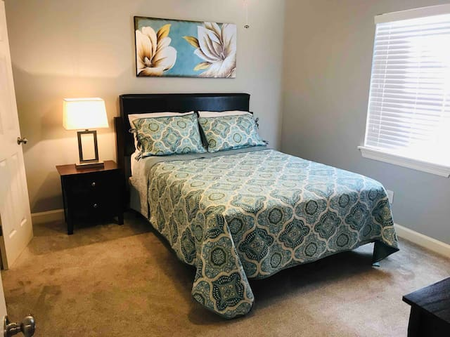 Spacious bedroom with comfortable Queen size bed.  Each bedroom has it's own private bathroom and walk-in closet.