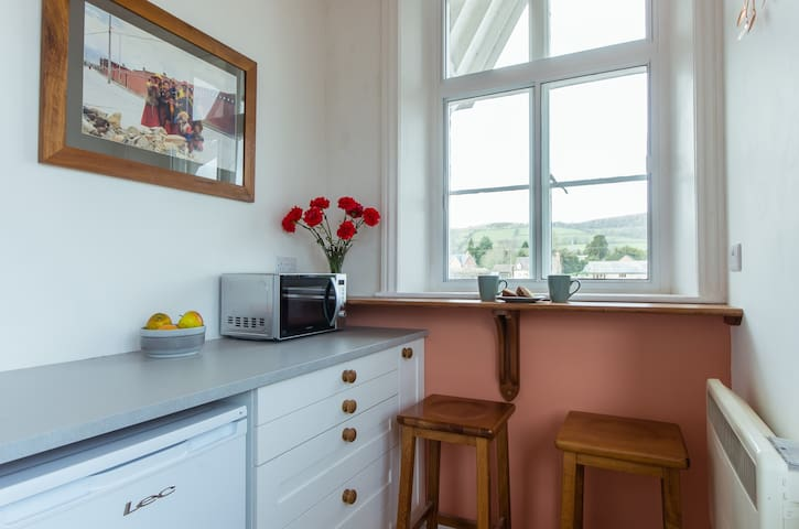 The newly installed kitchen has a hob, oven and microwave, but the big attraction is the breakfast bar, with beautiful views over Bucknell Mynd
