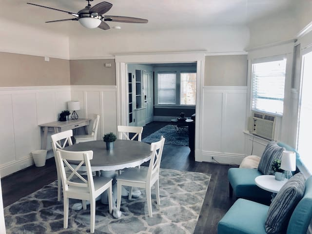 Dining room with desk/office space in background