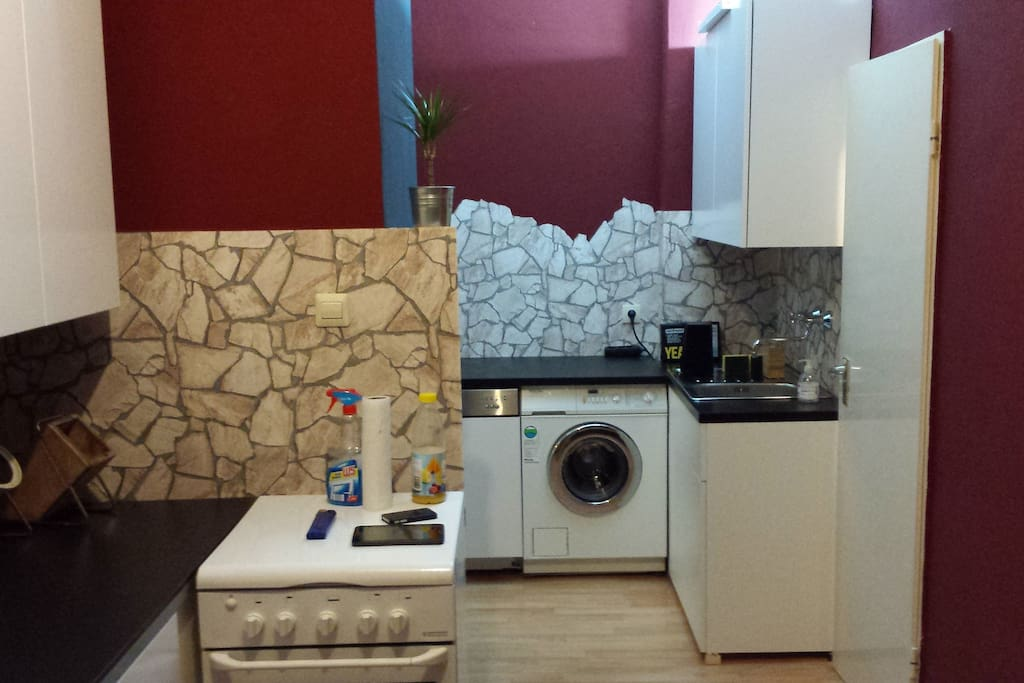 kitchen with washing machine, dishwasher and gas stove