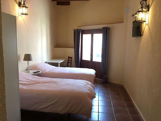 Vierpersoonskamer met eigen badkamer (Laïs)