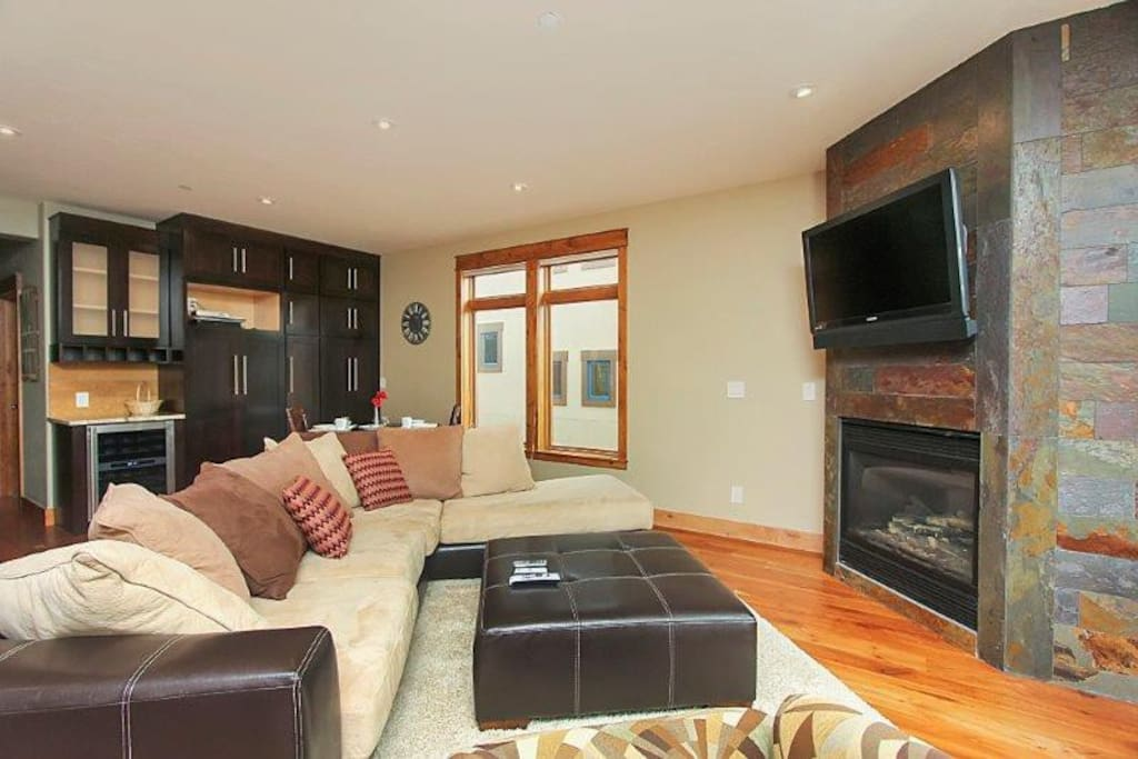 Expansive living area with flat screen TV and fireplace