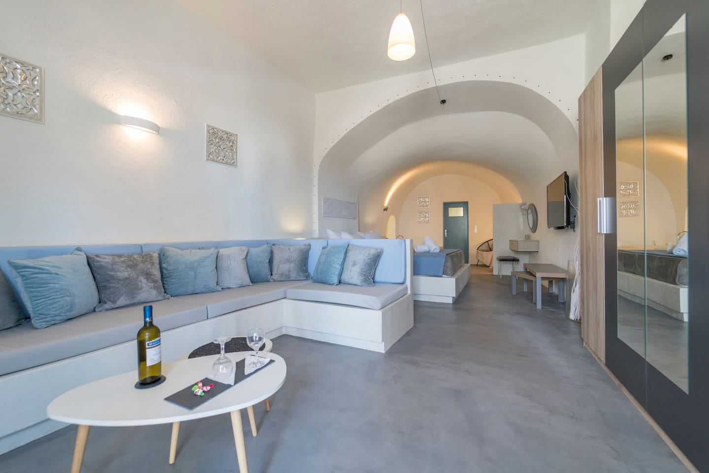 Private Cave suite with living room, big wardrobe, king size bed,  air condition, 50 inches satellite-smart television and kitchen.