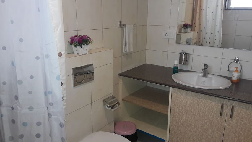 Attached bath with hot shower