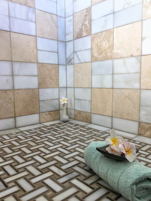 Master Bathroom: Custom installed tile with luxurious walk-in dual head shower