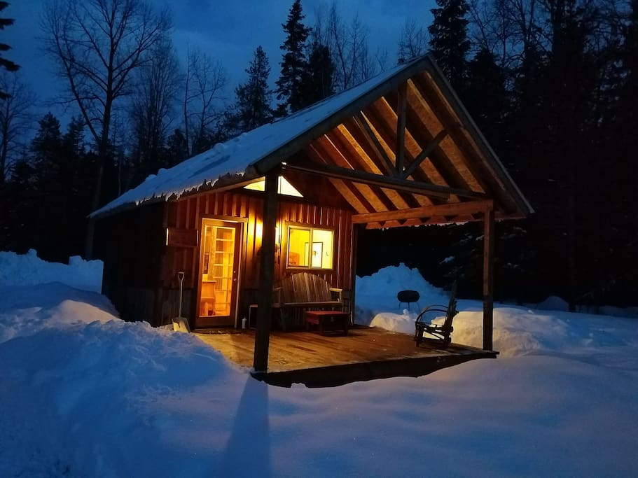 The cabin looks extra cozy in this snowy scene.