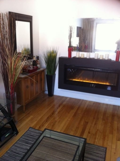 Living room with big realistic fireplace