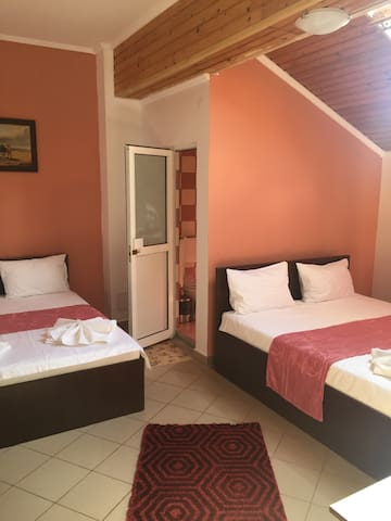 Orange bedroom in Mamaia