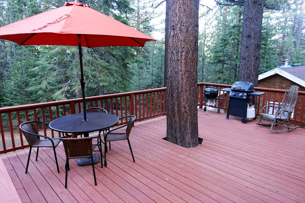 Big deck for bbq and hanging out. Keep an eye out for the bears out back, they have a favorite tree in our backyard :)