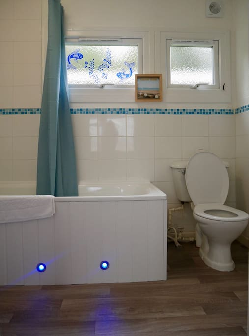 Bathroom complete with shower/bath, led mirror, motion censored lights, silent extractor fan and heated towel rail
