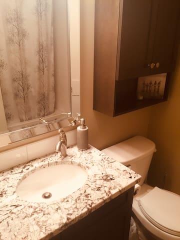 Main Bath, double shower heads, soaker tub, dual flush toilet, granite counter, hairdryer