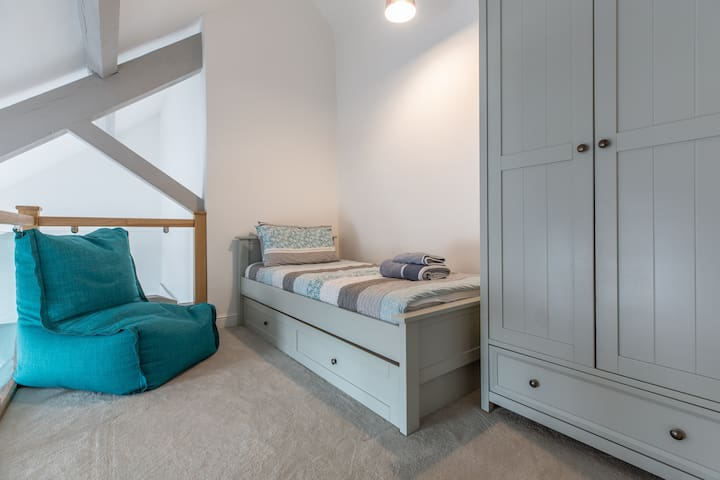 This single bed in the mezzanine has another pull-out singe bed underneath.