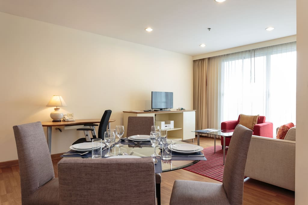 Living & Dining Area  Features: •1 Living & Dining Area •2 Bedrooms •2 Bathrooms •1 Kitchen •Apartment Size: 96 sqm / 1,033 sq ft •King-size bed and 2 single beds •Max 5 (5th person is chargeable with an extra bed) person(s)