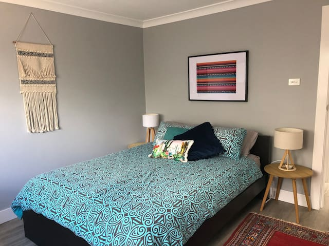 Bedroom with a subtle Mexican feel. Study area in the corner. Facility for hanging of clothes included.