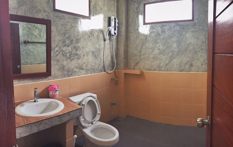 Private bathroom with hot shower.