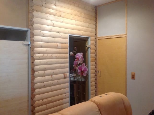 Entrance to room is far right door in picture.  Room is next to the shower, with orchid picture on door, and WC (far left door)