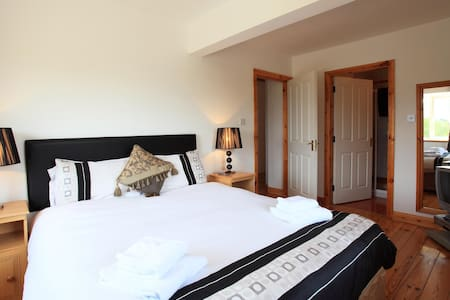 Our standard three bed house consisting of one master double bedroom ensuite, one twin bedroom and a single bedroom sleeping up to 5 people. Breakfast not provided. MINIMUM - THREE NIGHT STAY. Our homes - your haven!!! Stunning location.