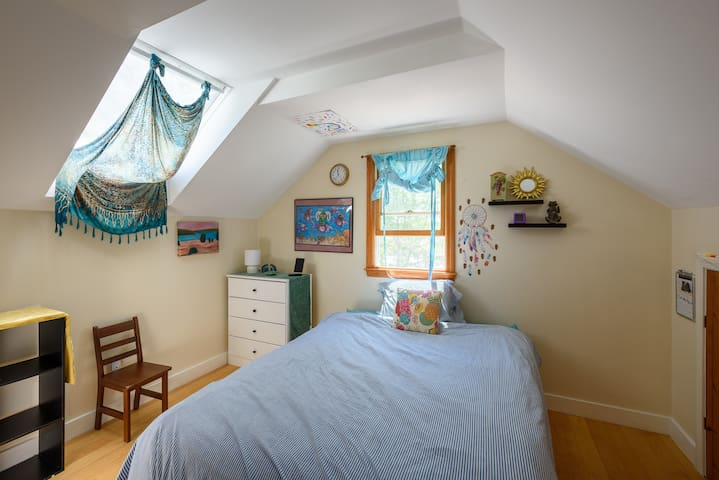 Bedroom #4 is right across the hall from Bedroom #3 on the second floor. A touch of whimsy. Great for a young adult or grown-up who is in touch with a bit of art and whimsy! Full size bed.
